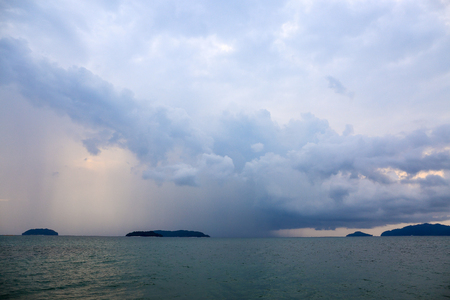 squall: Rain squall. Dramatic clouds over the sea, Shower clouds are coming. Stock Photo