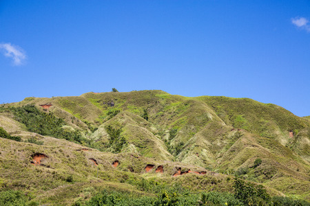 clear day: Green hills on clear day. Stock Photo