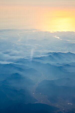 Aerial view from the an airplane at sunrise time in South Korea.