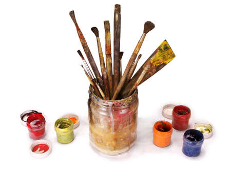 Old paint brushes in a jar
