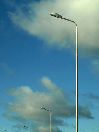 Street lamps on cloudy background photo