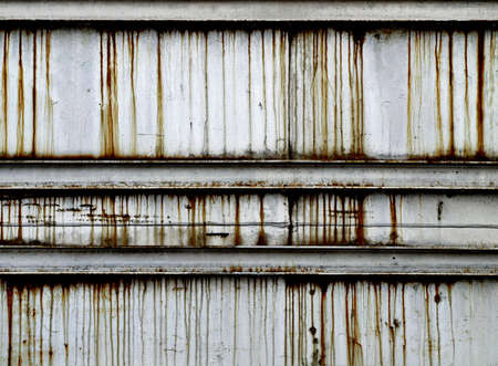 Stained rusty metal wall photo