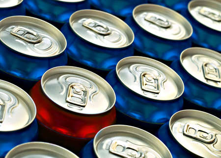 croud: Red beer can standing out from the croud of Blue beer cans Stock Photo