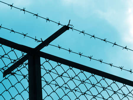 Prison fence silhouette Stock Photo - 4765190