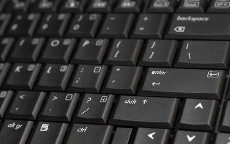 Black laptop keyboard closeup photo
