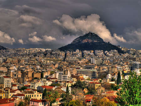 Athens city view from Acropolis with Lycabetus mountain in the background. HDR photo. Stock Photo