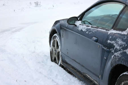 Unrecognizeable car stuck in the snowfield
