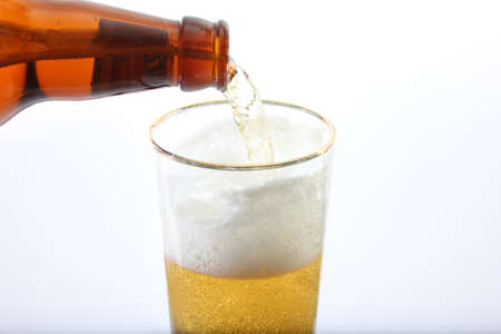 Beer glass and bottle close-up shot Stock Photo