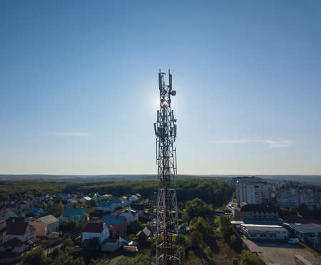 Communication tower 5G, 4G against the background of the setting sun
