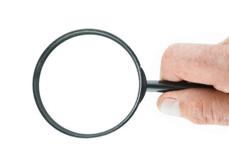 Hand holds a magnifying glass with clipping paths