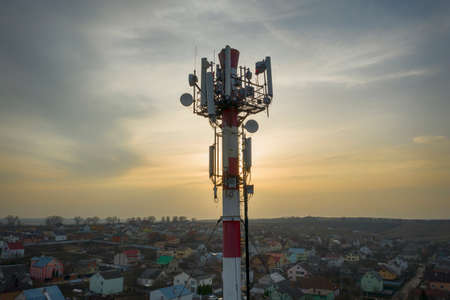 Communication transmitter tower with antenna such a Mobile phone tower, Cellphone Tower, Phone Communication transmitter tower with antenna such as mobile phone tower, mobile phone tower, telephone pole, etc. Against the backdrop of sunset, today the concept of global technology.