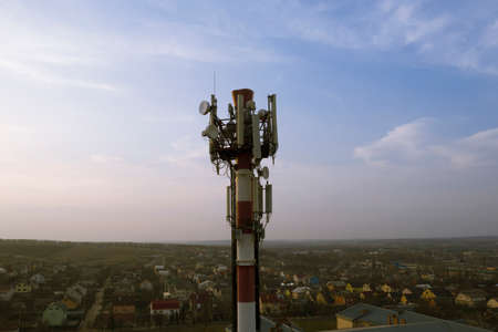 Communication transmitter tower with antenna, such as mobile phone, mobile phone, telephone, radio.