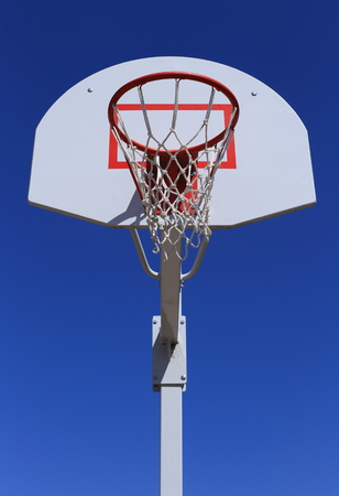 durable: Basketball basket on blue sky background. durable mesh. Stock Photo