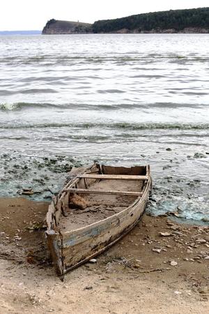 Old broken boat on the river
