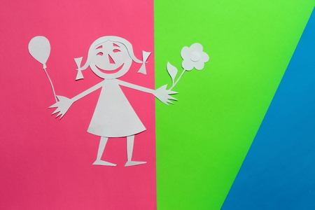 background of colored cardboard. the girl is made of white paper. in the style of a funny cartoon.