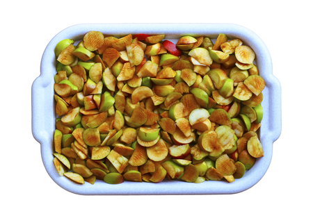 Ripe, bright apples in the dishes. isolate on white background.vegetarianism and vitamins