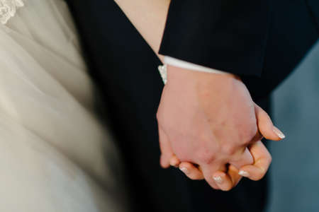 engage: Groom and brides hands with rings, closeup view