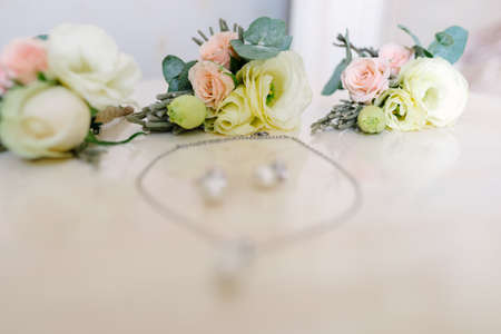 Earrings and bracelet for the bride on the wedding day Stock Photo