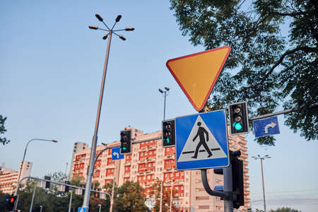 road sign in urban area pedestrian crossing