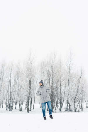 Outdoor portrait of a beautiful bearded man in a jacket and jeans. Casual winter fashion Stock fotó