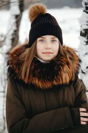 Portrait of a girl, feel cold in winter, outdoors.
