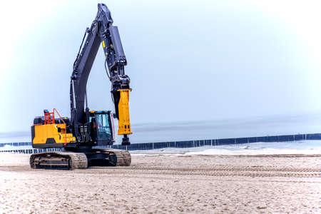 Construction machine beach Trzesacz West Pomeranian