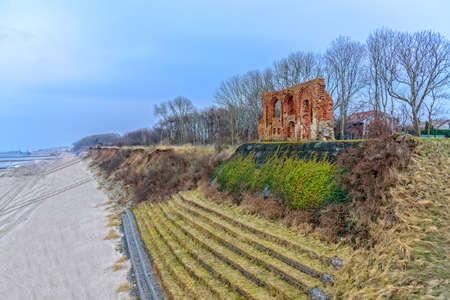 The ruins of the church in Trzesacz beach Baltic Sea coast