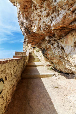 Path rock face Grotta di Nettuno Sardinia