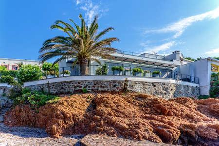 Vacation house rocks Mediterranean coast Palm tree architecture