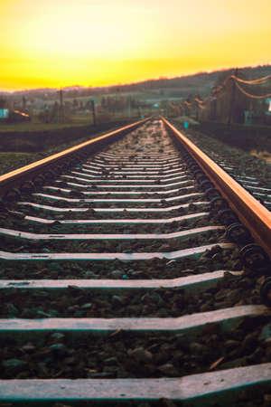 railroad tracks through the village in the mountains Standard-Bild