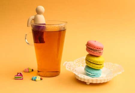 yellow tea pot: MOdern teapot and macaroons