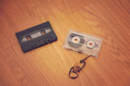 bygone days: Cases of bygone days. The old cassettes lie on the floor. Stock Photo