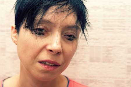 A woman cries because of a large disorder and depression.