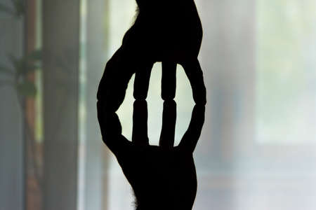 Conceptual photo of mens hands in the counter light.