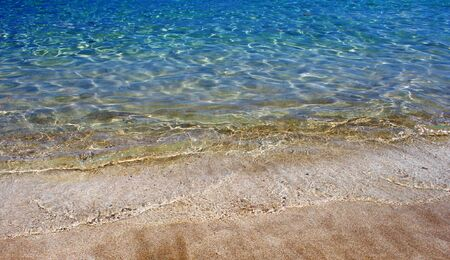 Crystal clear sea water at the beach Stock Photo