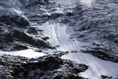 inhospitable: hostile to life the high mountains