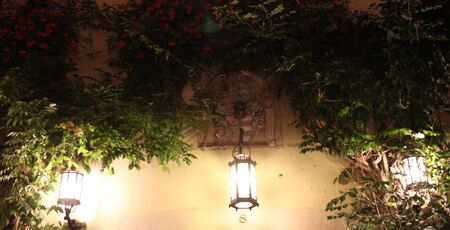 outdoor electricity: Lanterns on the wall Stock Photo