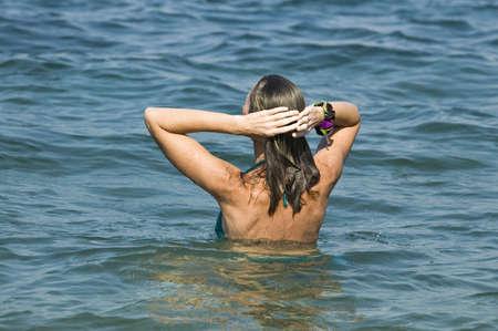 The woman bathes in Black sea Stock Photo