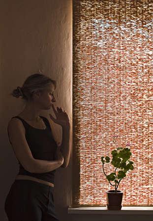 Portrait near a window