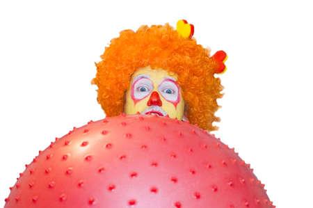 The clown behind a ball Stock Photo