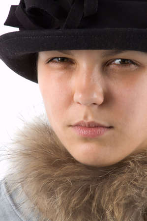The girl in a hat steadfastly looks at the photographer Stock Photo