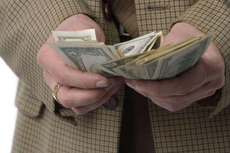 Money makes money. The man in a checkered jacket recalculates money