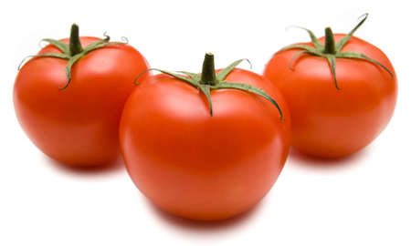 Three fresh red tomato isolated on a white background Stock Photo