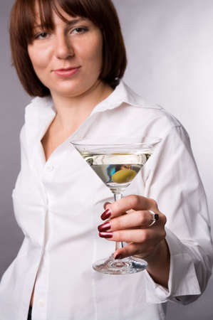 The woman in a white shirt with a glass of martini photo