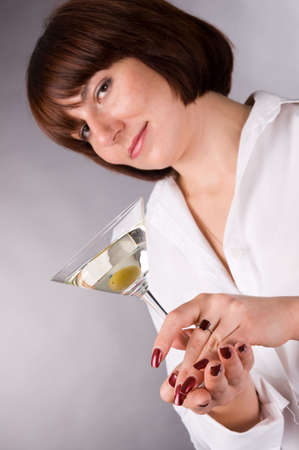The woman in a white shirt with a glass of martini Stock Photo - 2587698