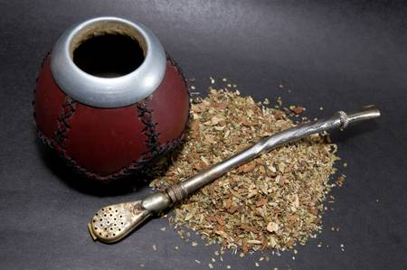 Cup from calabash with yerba mate tea and straw.
