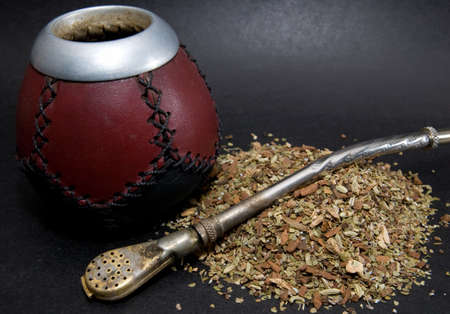 Cup from calabash with yerba mate tea and straw. Stock Photo - 2914587