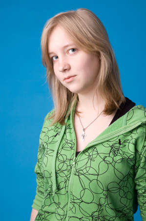 green clothes: The young girl in green clothes on a dark blue background.