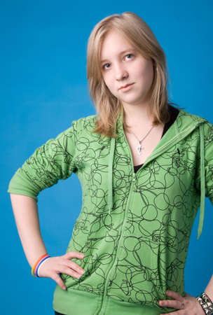 The young girl in green clothes on a dark blue background.