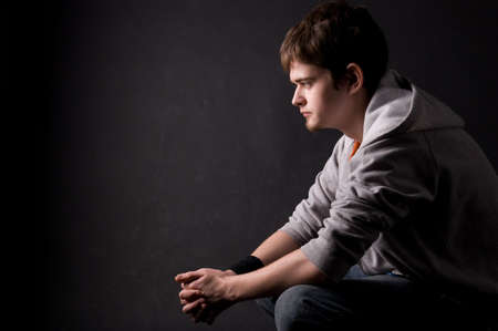 The young guy in studio on a black background